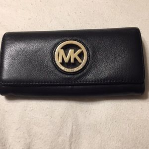 Authentic Michael  Kors wallet with  inside damage
